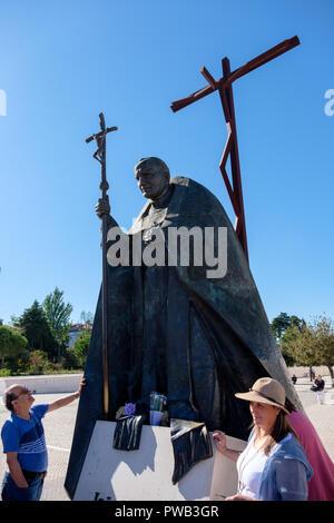 Statue of Pope John Paul II by polish sculptor Czeslaw Dzwigaj at the Fatima sanctuary in Portugal, Europe - Stock Photo