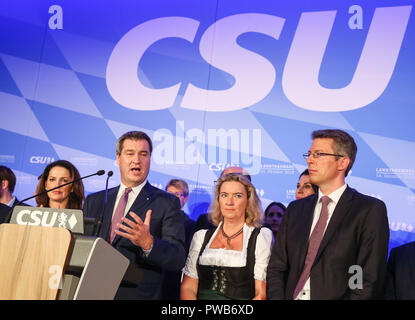 Munich, Germany. 14th Oct, 2018. German Christian Social Union's candidate and Bavarian governor Markus Soeder (3rd R, Front) delivers a speech after the initial forecast at the Maximilianeum in Munich, Germany, on Oct. 14, 2018. The Christian Social Union (CSU), one of the three ruling parties in Germany, suffered great loss Sunday in the state election in Bavaria, according to the initial forecast by the public broadcasters ARD and ZDF. Credit: Shan Yuqi/Xinhua/Alamy Live News - Stock Photo