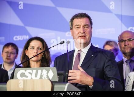 Munich, Germany. 14th Oct, 2018. German Christian Social Union's candidate and Bavarian governor Markus Soeder (R, Front) delivers a speech after the initial forecast at the Maximilianeum in Munich, Germany, on Oct. 14, 2018. The Christian Social Union (CSU), one of the three ruling parties in Germany, suffered great loss Sunday in the state election in Bavaria, according to the initial forecast by the public broadcasters ARD and ZDF. Credit: Shan Yuqi/Xinhua/Alamy Live News - Stock Photo