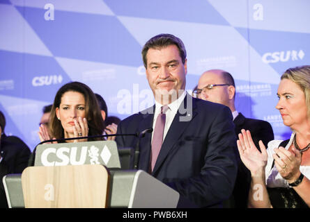 Munich, Germany. 14th Oct, 2018. German Christian Social Union's candidate and Bavarian governor Markus Soeder (C) reacts as he delivers a speech after the initial forecast at the Maximilianeum in Munich, Germany, on Oct. 14, 2018. The Christian Social Union (CSU), one of the three ruling parties in Germany, suffered great loss Sunday in the state election in Bavaria, according to the initial forecast by the public broadcasters ARD and ZDF. Credit: Shan Yuqi/Xinhua/Alamy Live News - Stock Photo