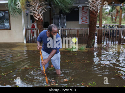 Panama City, FLORIDAY, USA. 10th Oct, 2018. A man stands in a flooded street after Hurricane Michael passed in Panama City, Florida USA on October 10, 2018. Hurricane Michael made landfall in the Florida panhandle as a Category 4 hurricane. Credit: Dan Anderson/ZUMA Wire/Alamy Live News - Stock Photo