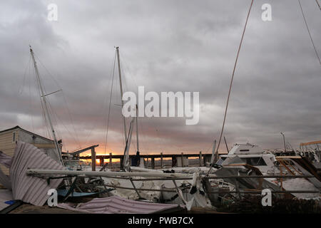 Panama City, FLORIDAY, USA. 10th Oct, 2018. Wrecked boats sit in the water after Hurricane Michael passed in Panama City, Florida USA on October 10, 2018. Hurricane Michael made landfall in the Florida panhandle as a Category 4 hurricane. Credit: Dan Anderson/ZUMA Wire/Alamy Live News - Stock Photo