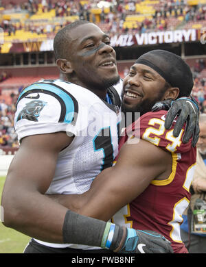 Landover, Maryland, USA. 14th Oct, 2018. Washington Redskins cornerback Josh Norman (24) hugs his former teammate Carolina Panthers wide receiver Devin Funchess (17) following the game at FedEx Field in Landover, Maryland on October, 2018. The Redskins won the game 23 - 17 Credit: Ron Sachs/CNP/ZUMA Wire/Alamy Live News - Stock Photo
