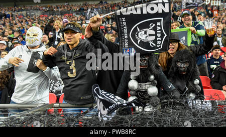 London, UK.  14 October 2018. Raiders fans. Seattle Seahawks at Oakland Raiders NFL game at Wembley Stadium, the first of the NFL London 2018 games. Final score Seahawks 27 Raiders 3.  Credit: Stephen Chung / Alamy Live News - Stock Photo