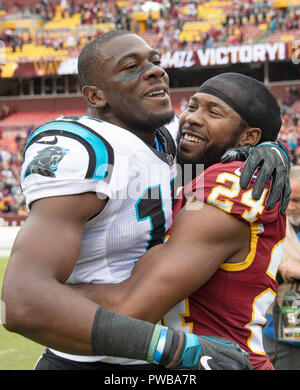 Landover, Maryland, USA. 14th Oct, 2018. Washington Redskins cornerback Josh Norman (24) hugs his former teammate Carolina Panthers wide receiver Devin Funchess (17) following the game at FedEx Field in Landover, Maryland on October, 2018. The Redskins won the game 23 - 17. Credit: Ron Sachs/CNP /MediaPunch Credit: MediaPunch Inc/Alamy Live News - Stock Photo