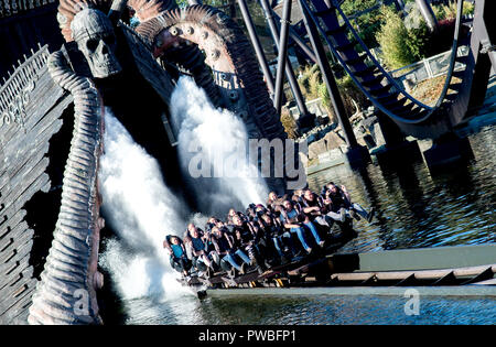 Soltau, Lower Saxony. 14th Oct, 2018. Visitors ride the roller coaster 'Krake' in Heide-Park. The so-called Dive Coaster was put into operation in 2011. Credit: Hauke-Christian Dittrich/dpa/Alamy Live News - Stock Photo