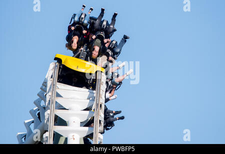 Soltau, Lower Saxony. 14th Oct, 2018. Visitors ride the roller coaster 'Limit' in Heide-Park. The suspension looping track was put into operation in 1999. Credit: Hauke-Christian Dittrich/dpa/Alamy Live News - Stock Photo