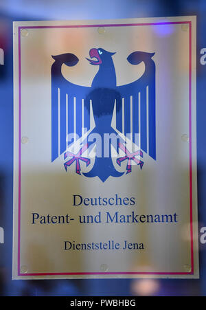 15 October 2018, Thuringia, Jena: The official sign at the entrance to the Jena office of the German Patent and Trade Mark Office. The East German branch of the Patent Office in Munich has been in existence for 20 years. The settlement was decided by the Federalism Commission in 1992. Since then, the employees have been responsible for design protection and, together with Munich, for trademark protection. The branch currently employs a total of 229 civil servants and employees. Photo: Martin Schutt/dpa-Zentralbild/dpa - Stock Photo
