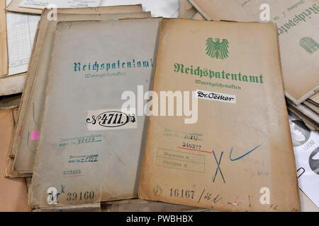 15 October 2018, Thuringia, Jena: Files are lying on a table in the historical examiner's room of the Jena office of the German Patent and Trade Mark Office. The East German branch of the Patent Office in Munich has been in existence for 20 years. The settlement was decided by the Federalism Commission in 1992. Since then, the employees have been responsible for design protection and, together with Munich, for trademark protection. The branch currently employs a total of 229 civil servants and employees. Photo: Martin Schutt/dpa-Zentralbild/dpa - Stock Photo