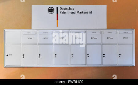 15 October 2018, Thuringia, Jena: The mailbox system of the Jena Office of the German Patent and Trade Mark Office has one mailbox for each day of the week. The East German branch of the Patent Office in Munich has been in existence for 20 years. The settlement was decided by the Federalism Commission in 1992. Since then, the employees have been responsible for design protection and, together with Munich, for trademark protection. The branch currently employs a total of 229 civil servants and employees. Photo: Martin Schutt/dpa-Zentralbild/dpa - Stock Photo