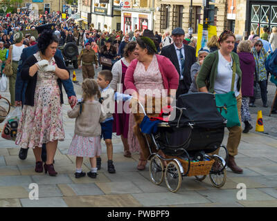 October 2018 women and children dressed in period civilian clothes worn during  World War two at an annual re-enactment in Pickering North Yorkshire - Stock Photo