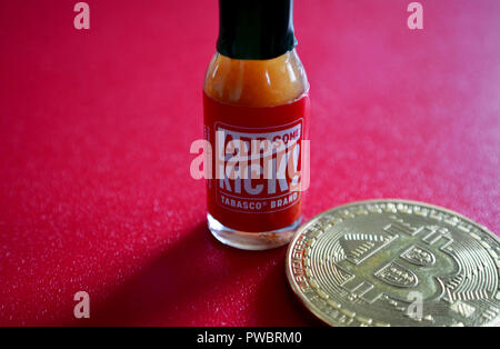 Bitcoin with Tabasco sauce bottle - Stock Photo