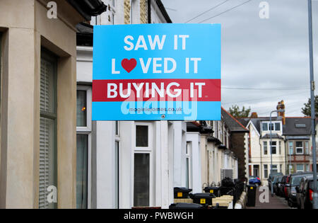 'Saw It, Loved It, Buying It' sold estate agent property sign outside a terraced house in Roath, Cardiff Wales UK  KATHY DEWITT - Stock Photo