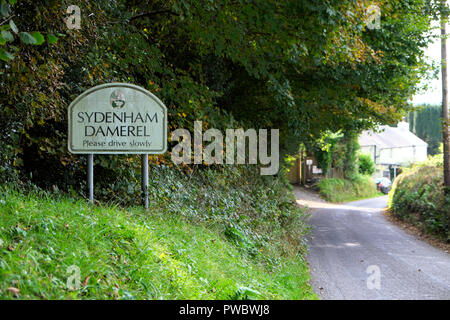 Sydenham Damerel sign on the road outside the village in rural Devon countryside in autumn England UK  KATHY DEWITT - Stock Photo