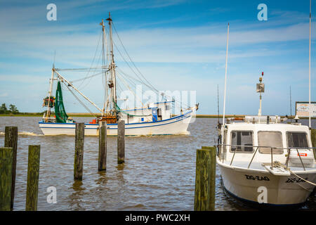 Fishing and tourist boats anchor and moor around the marina and docks in Apalachicola, FL on the bay in the Florida Panhandle - Stock Photo
