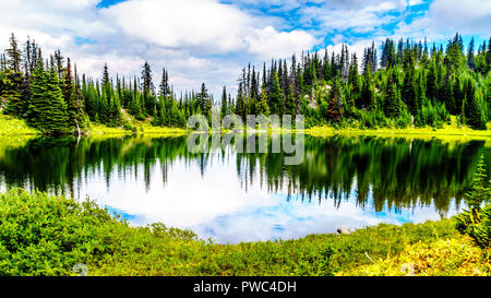 Tod Lake at an elevation of 6,545 feet is near the top of Tod Mountain at the alpine village of Sun Peaks in the Shuswap Highlands of British Columbia - Stock Photo