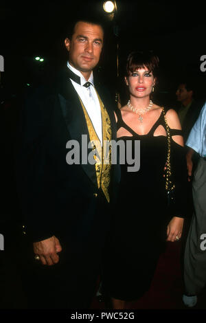 WESTWOOD, CA - OCTOBER 8: Actor Steven Seagal and model Kelly LeBrock attend Warner Bros. Pictures' 'Under Siege' Premiere on October 8, 1992 at Mann's Village Theater in Westwood, California. Photo by Barry King/Alamy Stock Photo - Stock Photo