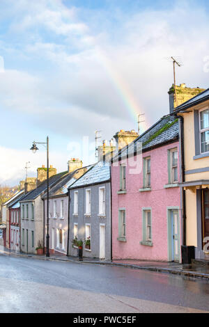 A rainbow over traditional houses along Main Street in Cong, on the border of County Galway and County Mayo in Ireland. - Stock Photo