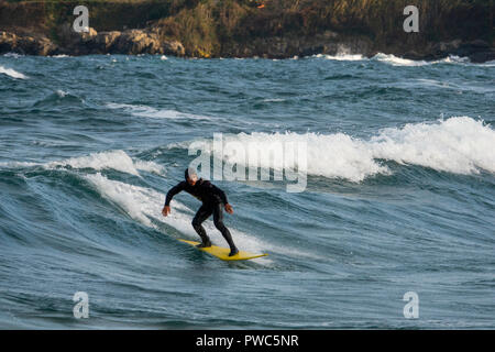 Surfer riding a wave on the Black Sea in Sozopol, Bulgaria - Stock Photo