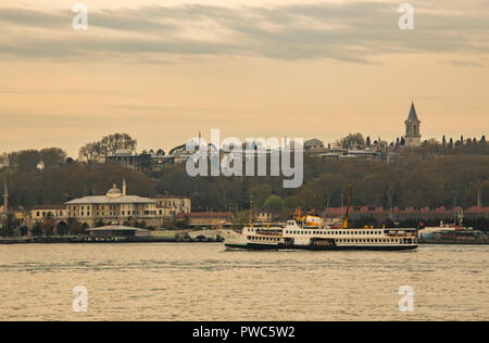istanbul,turkey-april 21,2017.old town and cityscape from istanbul and topkapı palace with city lines ferry. - Stock Photo