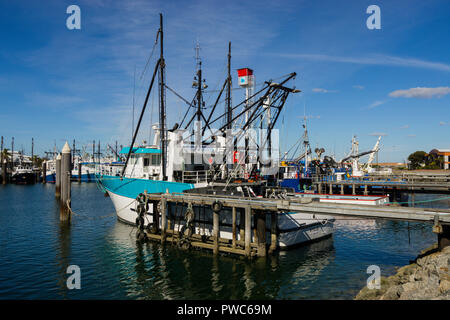 Tuna and fishing trawlers tied up at wharf in Port Lincoln South Australia - Stock Photo