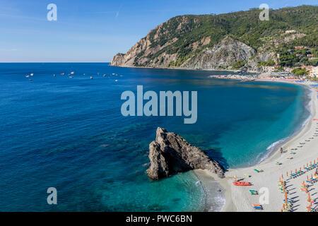 Fegina beach illuminated by morning light, Monterosso al Mare, Cinque Terre, Liguria, Italy - Stock Photo