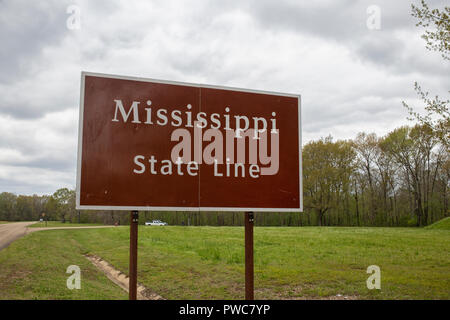 Sign of the Mississippi state line near the stateline of Alabama, USA - Stock Photo