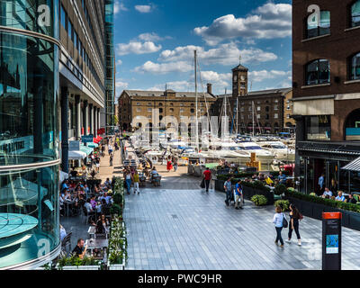 St. Katharine Docks Marina, an historic dock near Tower bridge and the Tower of London, now converted to a marina with offices, restaurants and bars. - Stock Photo