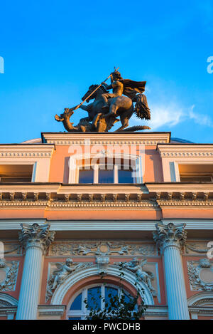 Vilnius architecture, statue of St George slaying a dragon sited on top of a Baroque building in Vilnius New Town (Gedimino Prospektas), Lithuania. - Stock Photo