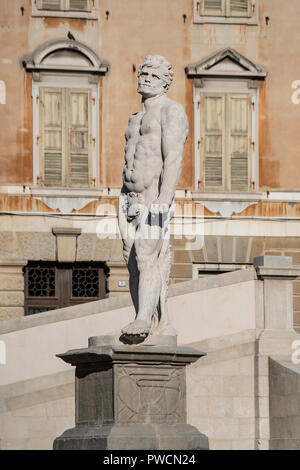 The statue of Hercules made by the sculptor Angelo de Putti in Freedom Square in Udine, Italy - Stock Photo