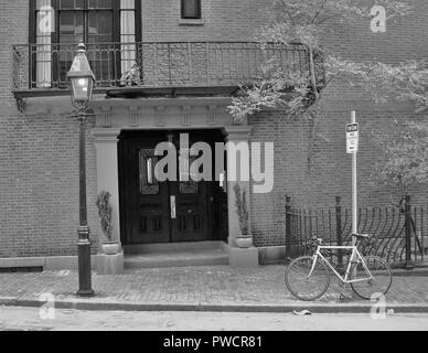 Boston street scene with old street lamp and modern bicycle. - Stock Photo