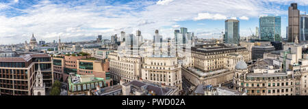 Daytime rooftop panoramic view over the City of London financial district including the Bank of England, Tower 42 and west to St Paul's Cathedral