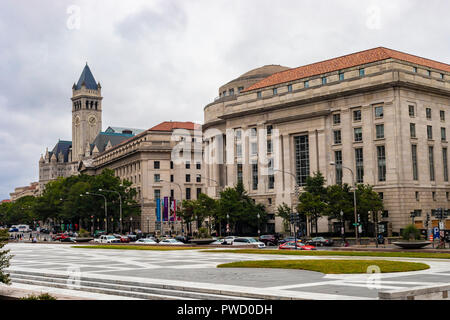 Washington DC, USA - October 12, 2017: Street view of the Old Post Office Pavilion building and clocktower and International Trade Centre building in  - Stock Photo