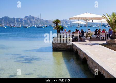 PORT DE POLLENCA, MAJORCA, SPAIN - September28th, 2018: People enjoy eating out in Port de Pollenca - Stock Photo