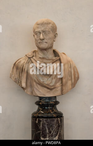 A bust of a Roman man in a toga on display in the Uffizi Gallery in Florence, Italy. - Stock Photo