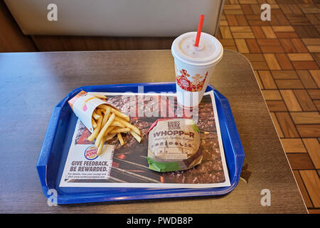 Burger King whopper hamburger, french fries and cold drink meal on the fast food restaurant dinner tray. - Stock Photo