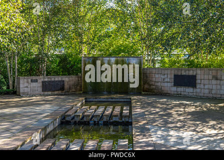 A small cascade fountain outside in David Welch Winter gardens in Duthie Park, Aberdeen, Scotland - Stock Photo