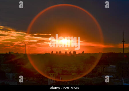 Panoramic view of Vilnius at sunset with circular lens flare, Lithuania - Stock Photo