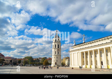 People walking on Cathedral Square in Vilnius, Lithuania: cathedral and bell tower - Stock Photo