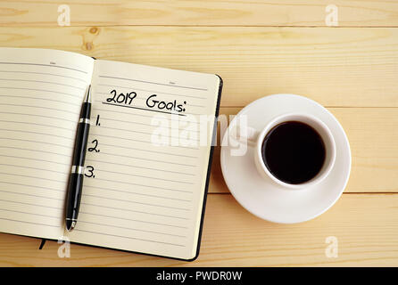 New year Concept - 2019 goals text on notepad. - Stock Photo