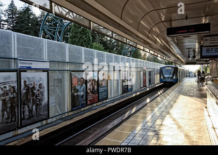 people waiting skytrain coming platform  in Patterson skytrain station burnaby BC Canada - Stock Photo
