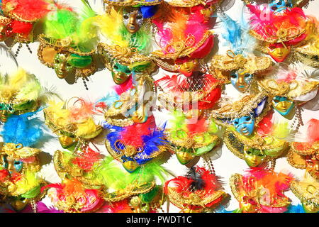 Venetian masks souvenir magnets on display at a stall on Piazza Delle Erbe(Market's square) central square in Verona, northern Italy. - Stock Photo