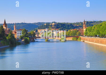 View of the Adige River and beautiful buildings at the banks seen from Ponte Aleardo Aleardi in Verona,Italy,July 18th 2018 - Stock Photo