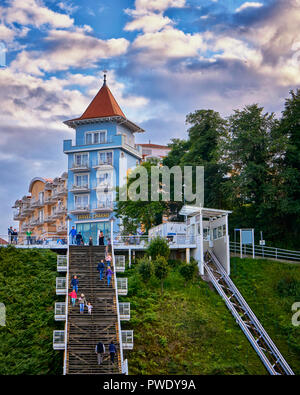 Sellin on Ruegen, Germany - View from the bottom up to the staircase with tourists, that connects the town of Sellin with the historic and low-lying p - Stock Photo