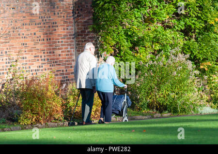 Glasgow, Scotland, UK. 15th October, 2018. UK Weather. An elderly couple visit the walled garden of  Bellahouston Park on a sunny afternoon. Credit: Skully/Alamy Live News - Stock Photo