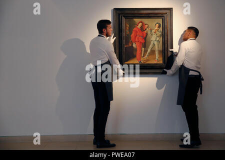 London, UK, 16th Oct 2018. Christie's art handlers hold Judith Leyster 's artwork 'Merry Company' at Christie's Auction House in London, UK, Tuesday October 16, 2017. The piece is expected to achieve up to £2.5million when is comes to auction as part of the Albada Jelgersma Collection sale during Christie's Classic Week in December. Photograph : Credit: Luke MacGregor/Alamy Live News - Stock Photo