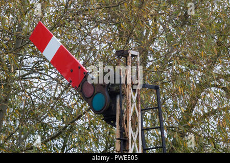 an old fashioned restored railway enamel semaphore stop signal at the nene valley railway in Peterborough at orton mere, Cambridgeshire. - Stock Photo