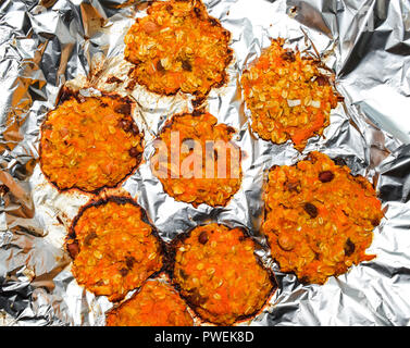 Baked in foil cakes from pumpkin and oatmeal - Stock Photo
