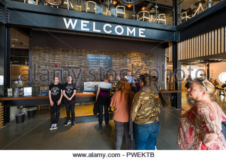 People standing in line to purchase tickets for a tour of the Teeling Distillery, Newmarket, Merchants Quay, Dublin, Leinster, Ireland - Stock Photo