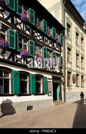 D-Bamberg, Regnitz, Main-Danube Canal, Upper Franconia, Franconia, Bavaria, alehouse Zum Schlenkerla in the old town, brewery, half-timbered house, green shutters, UNESCO World Heritage Site - Stock Photo
